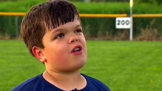 Awesome boy with dwarfism playing little league baseball