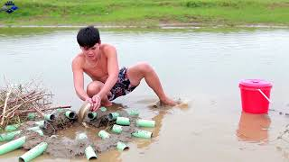 Primitive Life : Fish traps made of PVC pipes and deep holes , Trapped a lot of fish  skills fishing