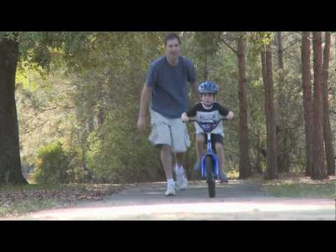Father Teaching Son To Ride Bike - Father and Son - HD Stock Footage