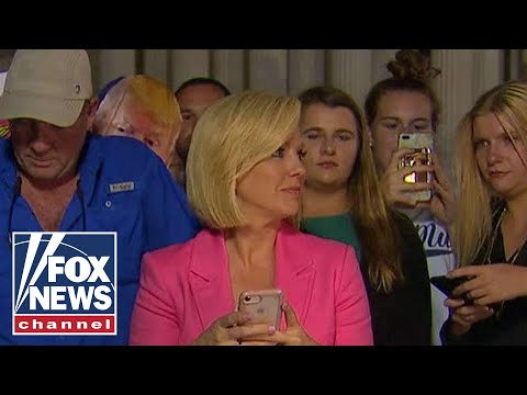 Protesters scream at Fox anchor