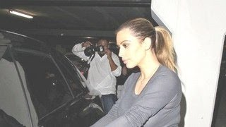 Kim Kardashian Pushes Baby North Into Swarm Of Paparazzi