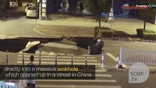 Camera captures sinkhole forming in China road, and motorcyclist riding into it