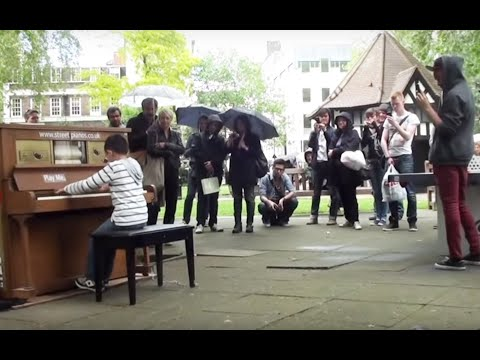 11 year old George Harliono plays Moonlight Sonata 3rd mov on a Street Piano in the rain.