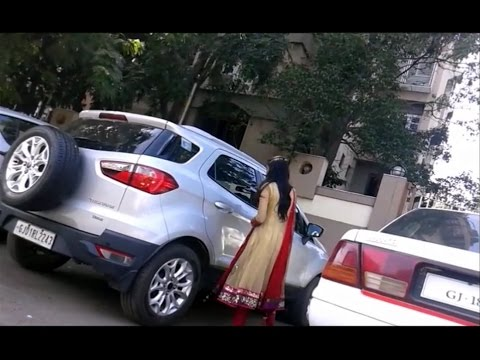 College Girl Driving Ford Titanium Car in Beautifull Red Dress