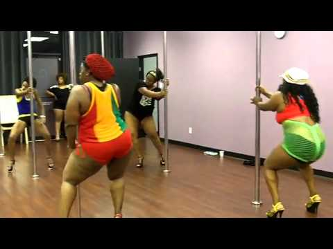 fluffy girls dancing on pole doing tricks