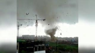 Tornado accompanied by rainstorm hits northeast China county