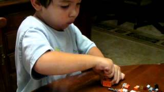 4 year old assembling lego