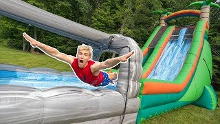 WORLDS BIGGEST INFLATABLE OBSTACLE COURSE!! (IN OUR BACKYARD)