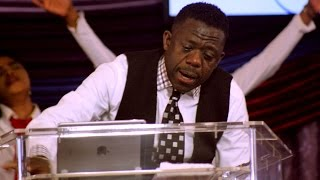Bishop Benjamin Dube praying in tongues
