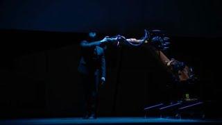 Engineer dances onstage with robot he programmed