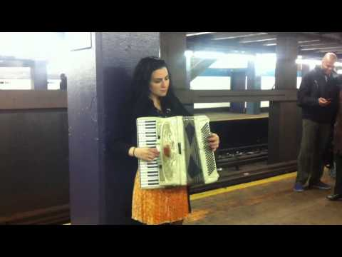Beautiful accordion girl Melissa Elledge plays Amélie by request