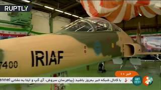 Iran unveils 1st domestic fighter jet, Rouhani gets in cockpit