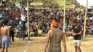 Naga boy takes a high jump to kick piece of meat : meat-kicking competition