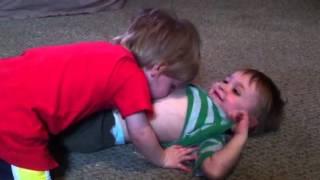 Jude blowing raspberries on Noah's belly :)