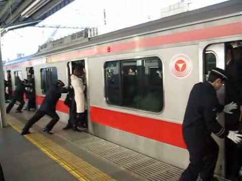 People stuffed onto a train in Tokyo, Japan (train stuffing Tokyo)