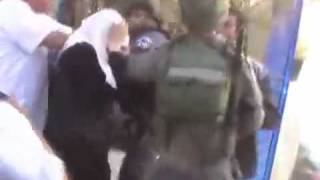 Hijab Woman gets hit on head and touched by Israeli Policeman after eviction