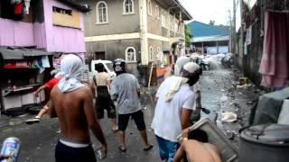 San Juan violent demolition 2012 - Police retreats then retaliates with teargas