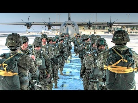 US Army Airborne Paratroopers Jump Into