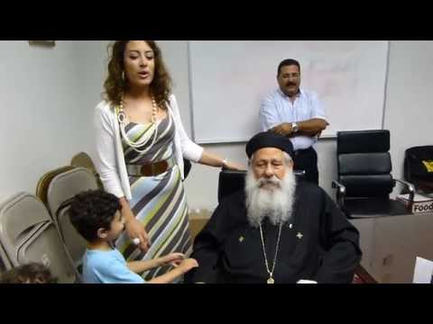 Nermeen Wasfy with Fr Makary Younan at St Mary church 2013