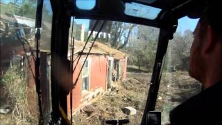 Excavator Smashing Old House