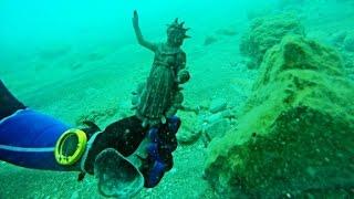 Divers discover ancient treasure trove in shipwreck
