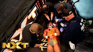 Adrian Neville gets stretchered out of the arena after his match with Kevin Owens