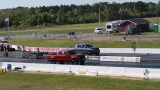 Download Supercharged Toyota Tundra vs Ford Raptor Drag Race 0 60