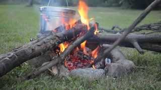 Survival Tips - How to cook on open fire coals with no pots and pans - Fish, Corn & Potatoes
