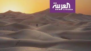 تفاعلكم : اماراتي يتحدى الخطر ويقف على حافة بركان