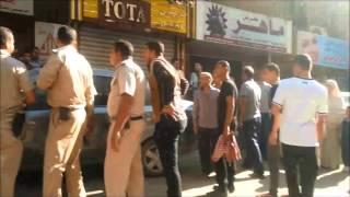شرطة سوهاج اثناء القبض على احد الاشخاص فى شارع 15