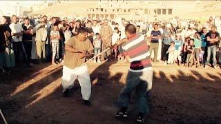 Combat de matraque 22  مبارزة بالعصا