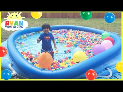 BALLOON POP CHALLENGE in Giant Inflatable Ball Pit Pool