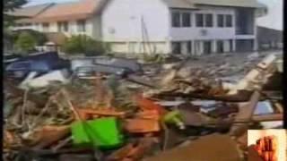 tsunami disaster  زلزال تسونامي ، إنشاد سمير البشيري.avi