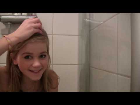 Young Swedish girl missbellali breakes an egg in the shower