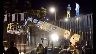Migrants on the US-Mexico Metal Fence Taunting American Border Agents!