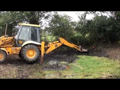 Digging out a pond with a JCB. Part 1