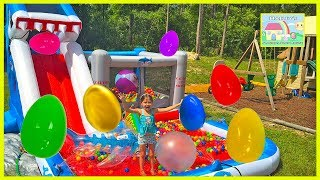 HUGE EGGS SURPRISE TOYS EGG HUNT on Inflatable Water Slide Disney Cars Toys Frozen Doll InsideOut