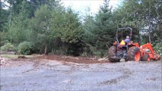 Using the Kubota MX5100 to knock down brush and level some ground