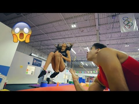 TEACHING MY WIFE HOW TO BACKFLIP super funny