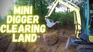 Clearing land area with a Yanmar sv17ex mini excavator