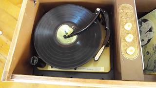 Magnavox automatic console record player with LP record