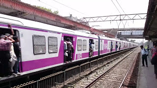 Mumbai Local New super Fast Train Passing a Station in India