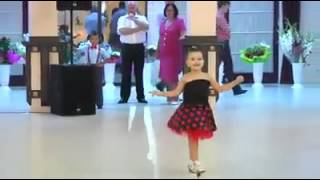 Little girl and boy dance in arabic song