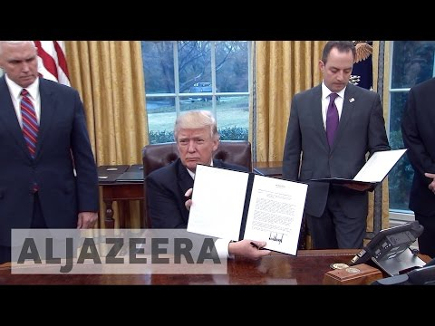 watch Trump withdraws US from TPP deal