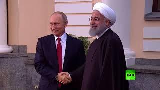 لحظة لقاء بين بوتين وروحاني في سوتشي