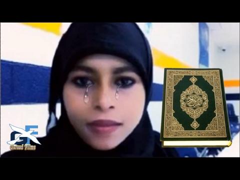 Subxanallah Gabar somali mareykan ah oo Horteeda kitaabka Qur,aanka lagu jex jeexay Naxdin
