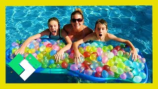 EPIC 300 WATER BALLOON FIGHT! KIDS VS PARENTS! (Day 1889)