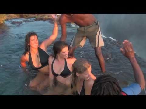 Girls defy death at Victoria Falls Devil s Pool Livingstone Island Zambia