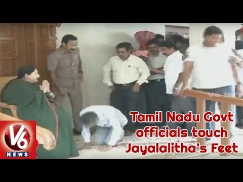 AIADMK Activists And TN Govt Officials Touch Jayalalitha's Feet After Grand Victory In Elections