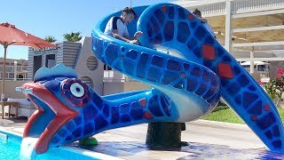Learn colors with funny kids & water slide in Aqua park outdoor playground. Family fun in real life